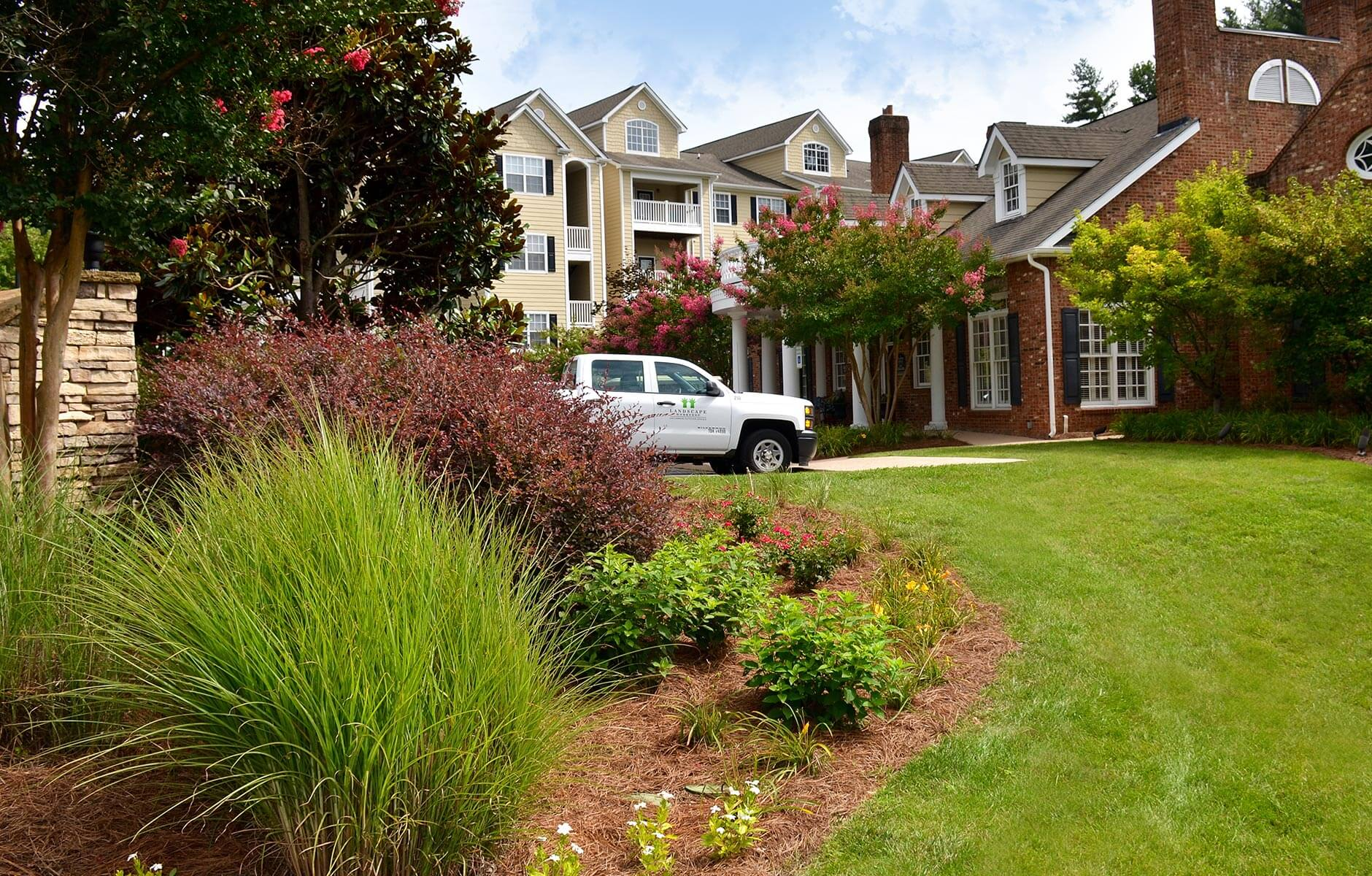 Colorful flower bed and green grass at a multifamily property