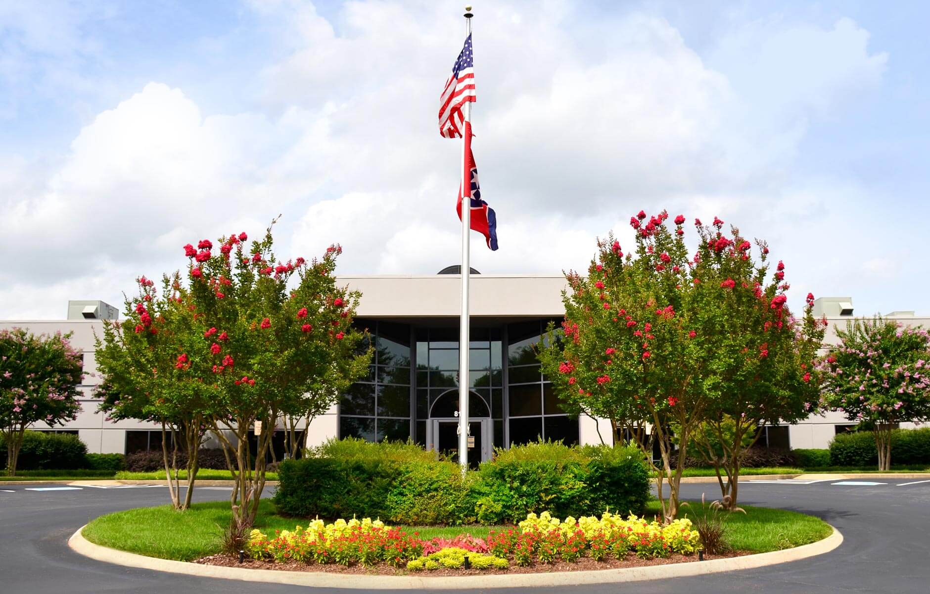 Office entrance enhanced with large flower, shrub and tree bed in Knoxville, Tennessee