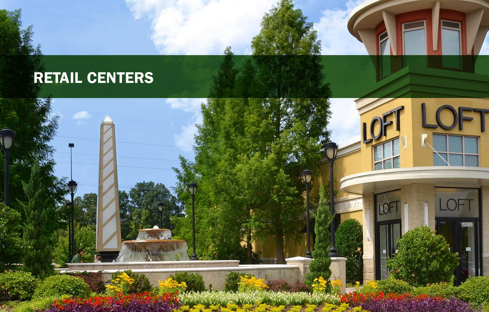 Colorful flower bed at retail center maintained by Landscape Workshop