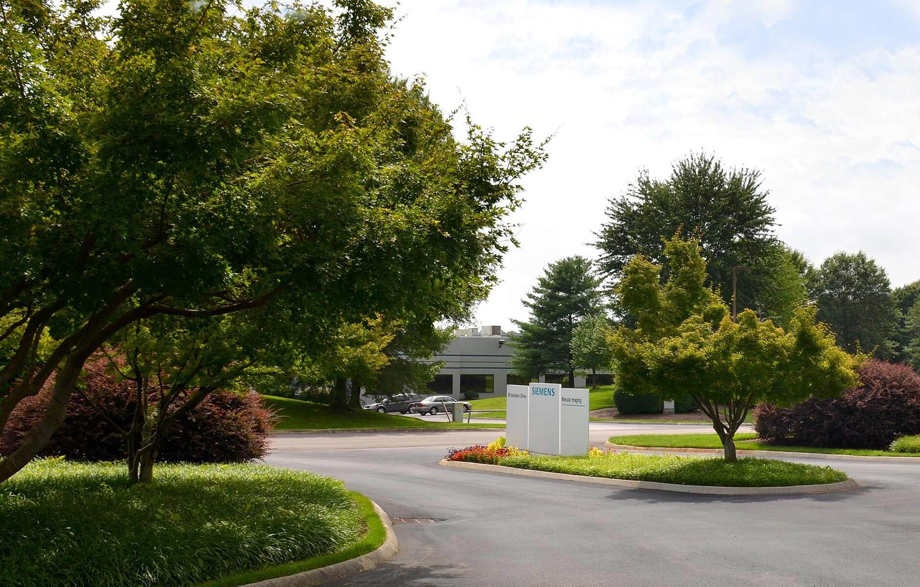 Industrial property with large flower and tree beds to enhance the view