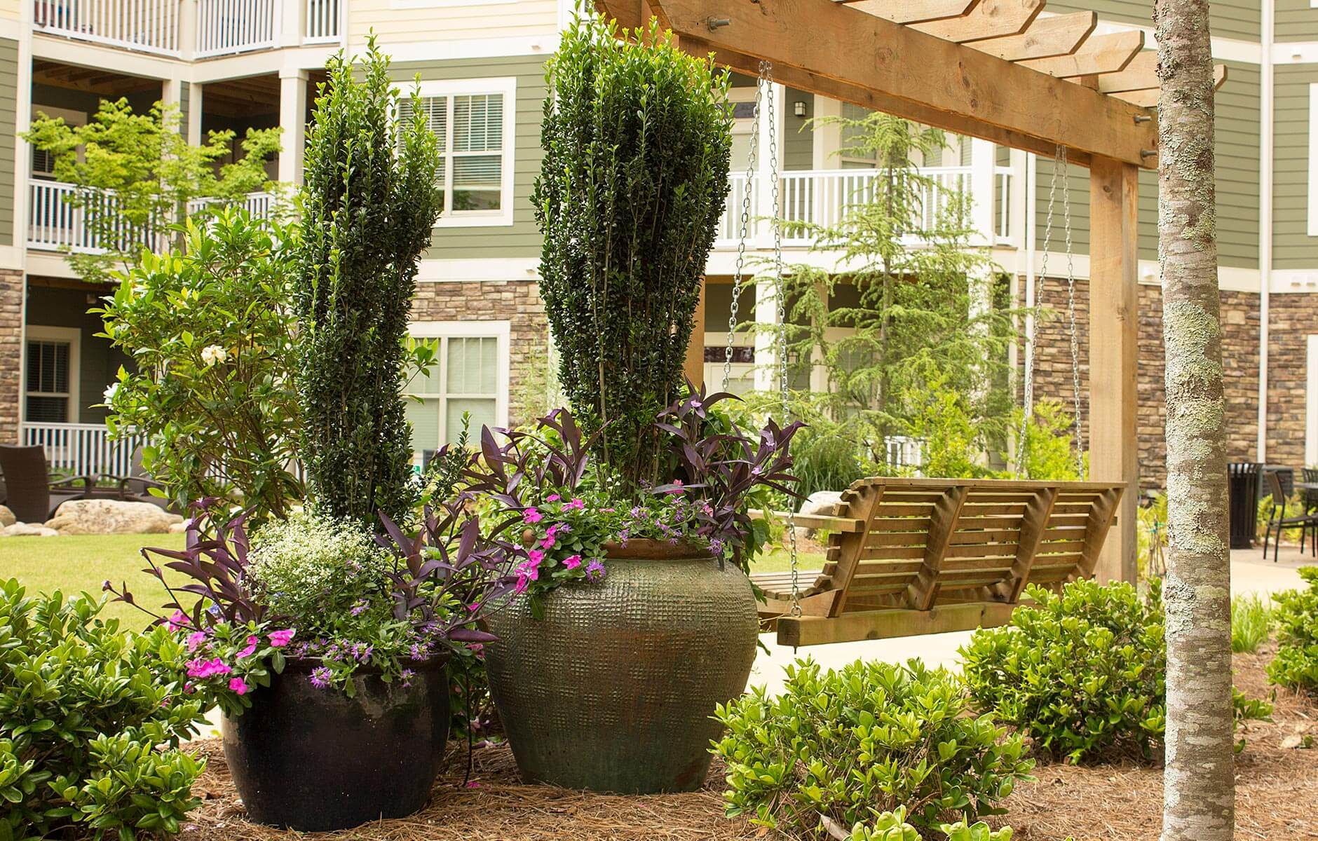 Large flower pots add appeal to this courtyard space