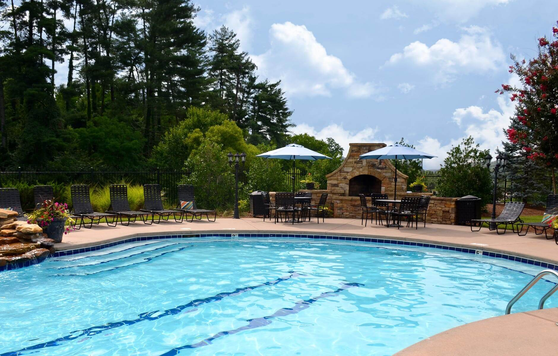 Multifamily property pool surrounded by inviting landscape