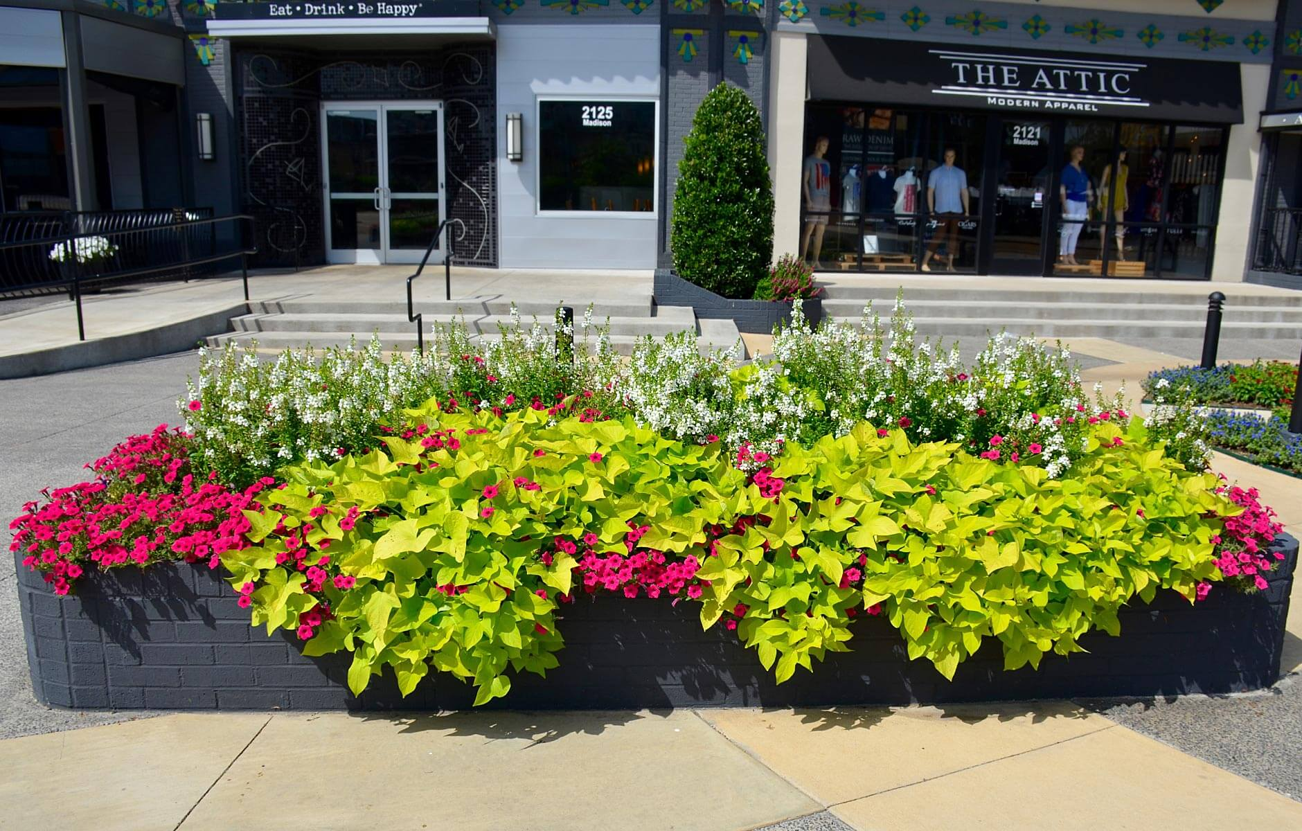 Bright and colorful raised flower bed featuring pink, white and green colors in Memphis, Tennessee