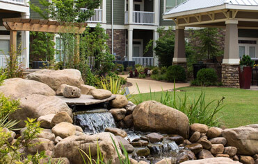 Fountain and greenery at a multifamily property