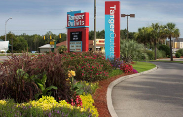Retail center entrance with seasonal color plan near Gulf Shores, Alabama