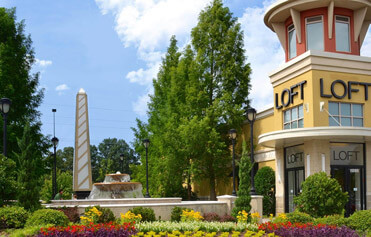 Seasonal color plan with red, yellow, purple and white flowers at Knoxville retail center