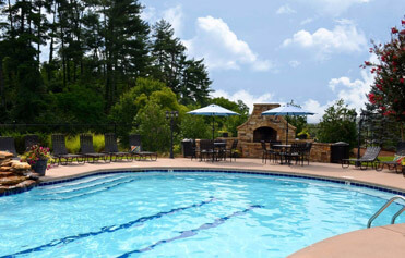 Landscape enhancements like large flower pots make this pool even more inviting to tenants