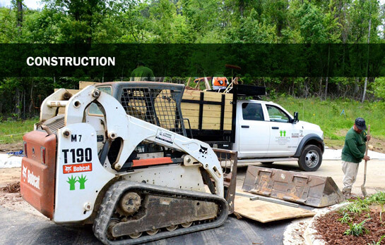 Landscape construction equipment on site performing installation services in Birmingham, Alabama