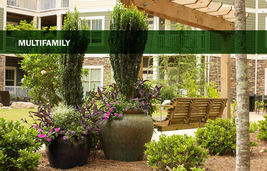 Large flower pots enhance the grounds at the multifamily property