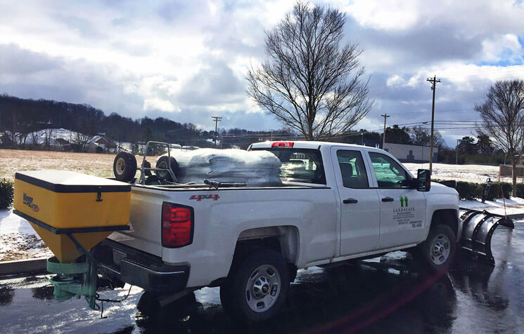 Snow plow and ice melt truck ready to go