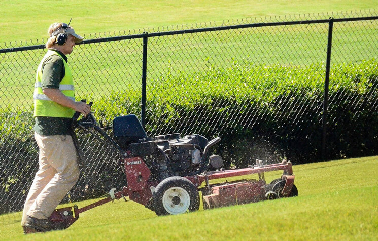 Mowing and maintaining grass at large retail center in Birmingham, Alabama