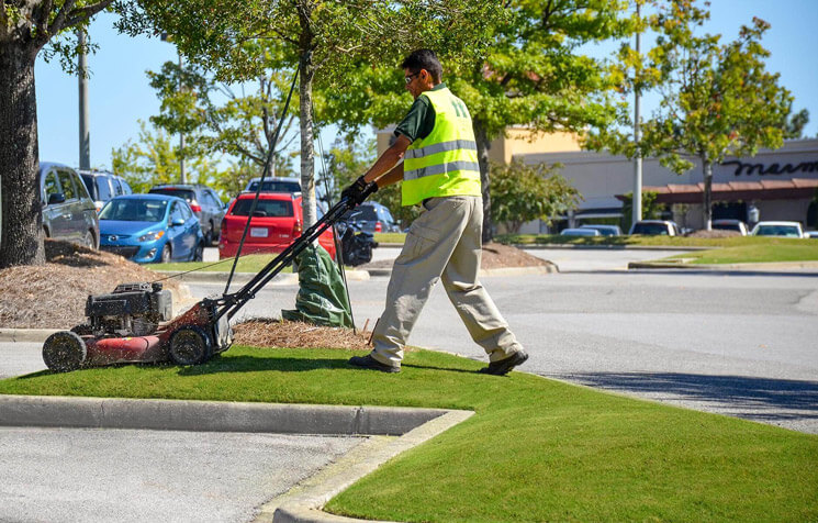 Mowing and maintaining grass at large retail center