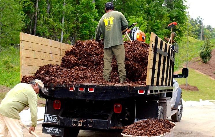 Installing mulch at a landscape construction site